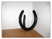 Single horseshoe coat rack